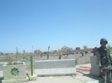 A lone Iraqi soldier stands guard as we drive by. I wonder if he is alive. 2004 or 2005, Tikrit, Iraq.